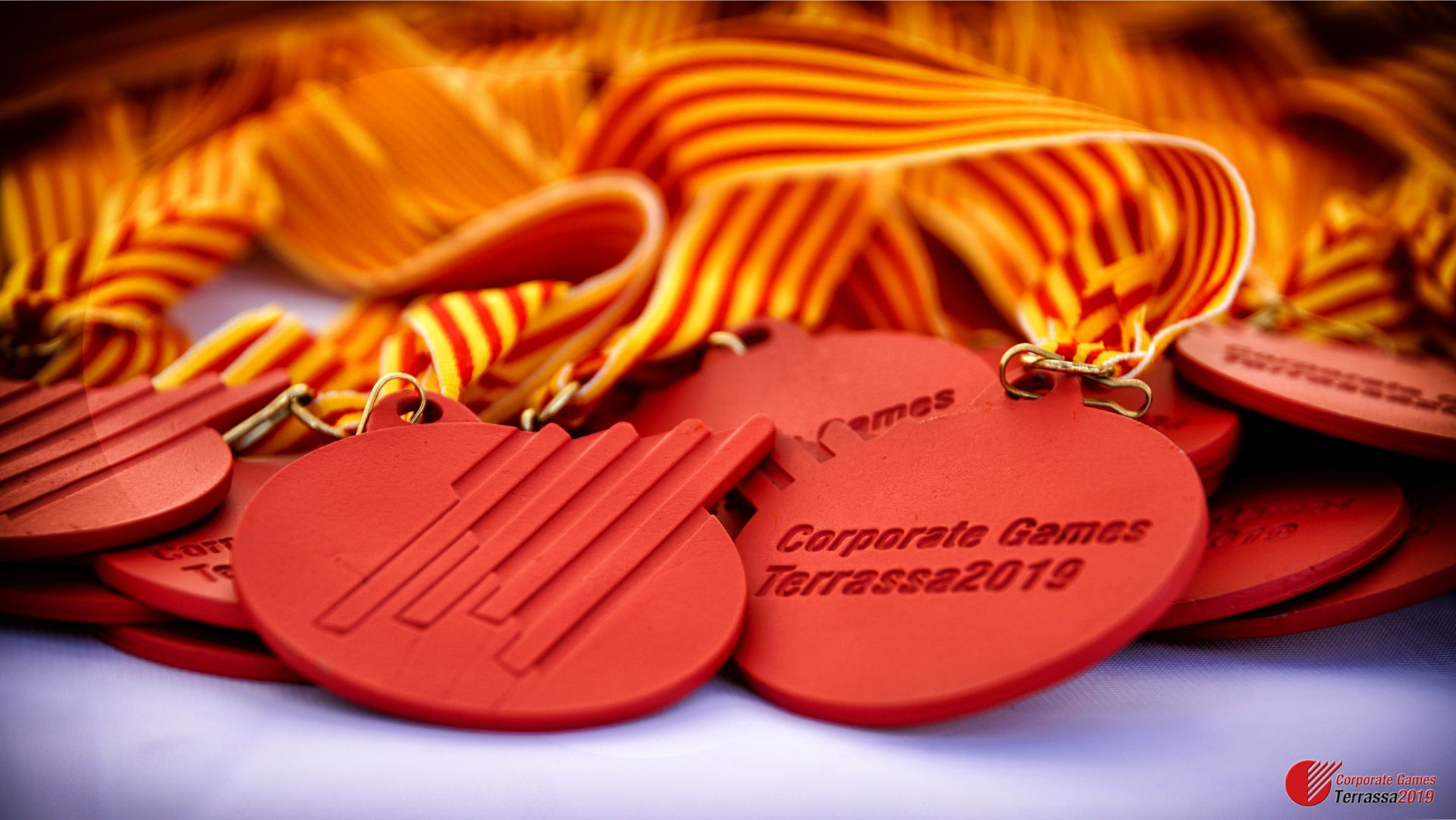 CORPORATE GAMES TERRASSA 2019-MEDALLAS-01676-Logo